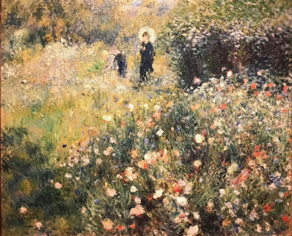 Mujer con sombrilla en un jardín. Renoir