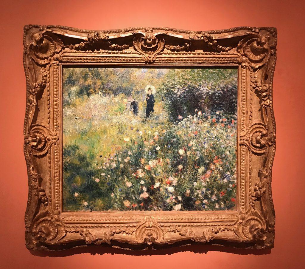 Mujer con una sombrilla en un jardin, 1873. Renoir